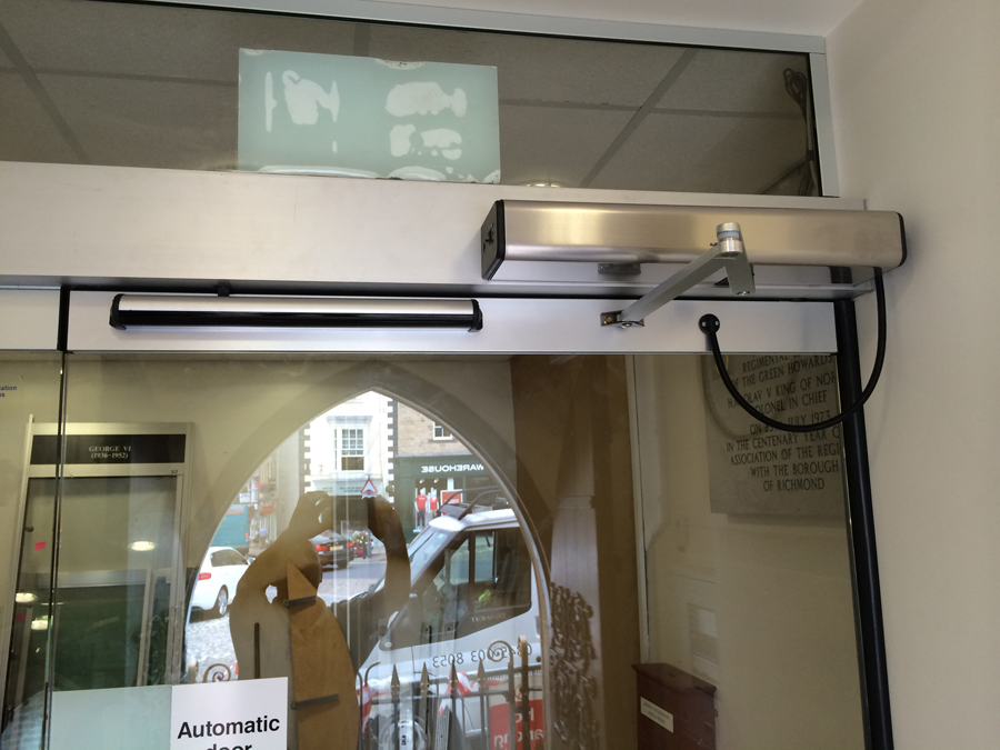 Power assisted swing door dda